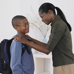 African mother seeing son off the school