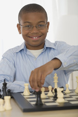 African boy playing chess