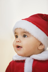 Studio shot of baby wearing Santa Claus outfit