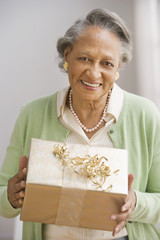 Senior African woman holding gift