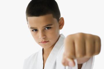 Studio shot of Hispanic boy in martial arts stance