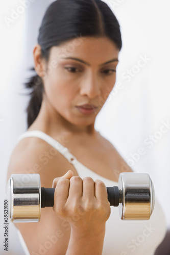 Indian woman lifting weights
