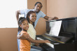 African family playing piano