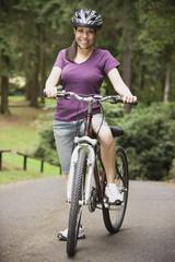 Portrait of Hispanic woman on bicycle