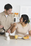 Hispanic couple having breakfast