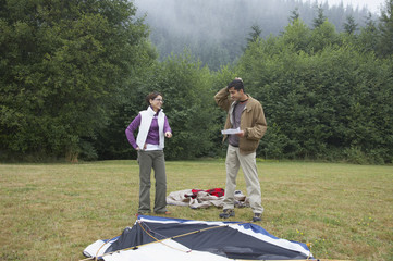 Indian couple putting up tent