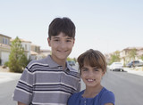 Portrait of brother and sister on residential street