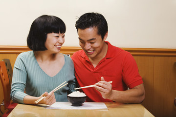 Asian couple eating rice
