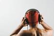 Asian man listening to headphones