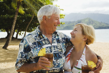 Senior couple smiling at each other in tropical scene