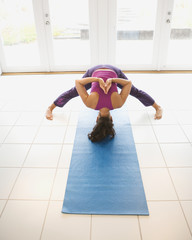 Hispanic woman practicing yoga