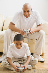 Indian father and son playing video games