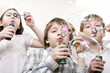 children blowing bubbles