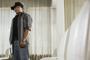 Hispanic man wearing headphones