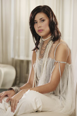 Portrait of Hispanic woman wearing fashionable clothing