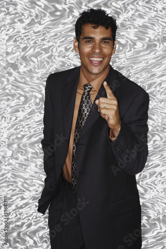Portrait of Hispanic businessman pointing