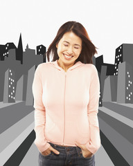 Asian woman laughing with hands in pockets