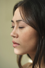 Profile of Asian woman with eyes closed