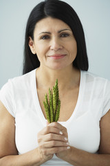 Hispanic woman holding bunch of grain