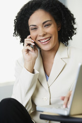 African businesswoman talking on cell phone
