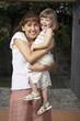 Hispanic mother hugging daughter