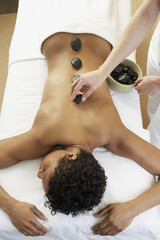 African woman receiving spa treatment