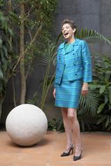 Hispanic businesswoman laughing
