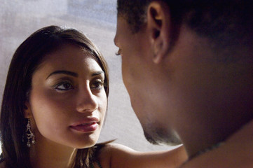 Multi-ethnic couple looking at each other