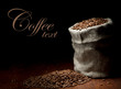 Burlap sack of coffee beans against dark wood background