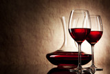 Fototapety decanter with red wine and glass on a old stone background