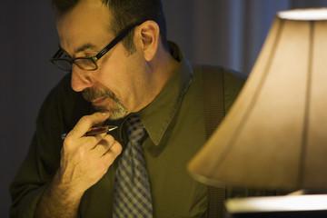 Hispanic businessman scratching chin