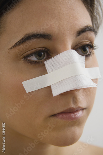 Native American woman with bandage on nose