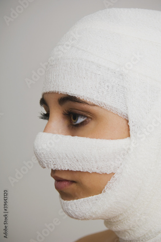 Native American woman with bandages around head