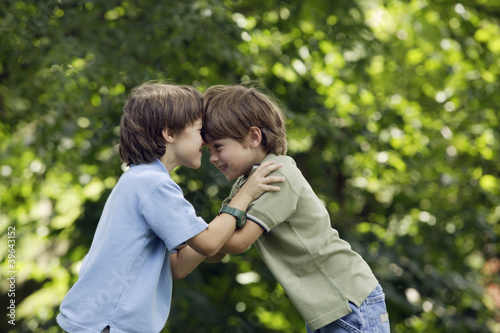 Two brothers playing outdoors