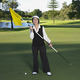 Senior Asian woman on golf course