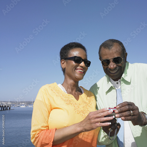 Senior African couple looking at camera