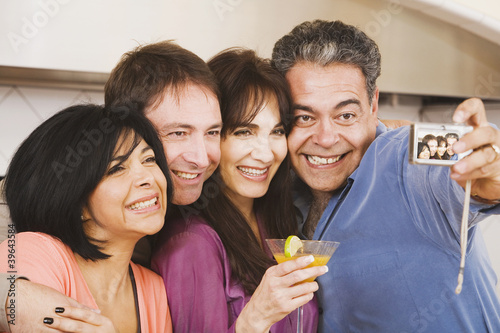 Multi-ethnic group of friends taking own photograph