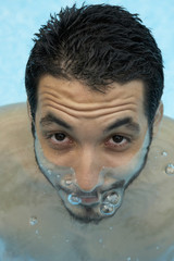 Hispanic man in swimming pool