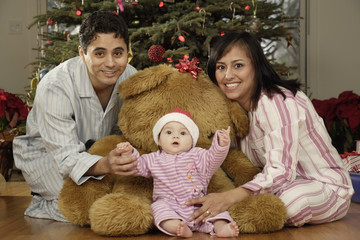 Hispanic parents and baby on Christmas