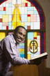 African American man with Bible in church