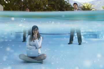 South American businesspeople in swimming pool