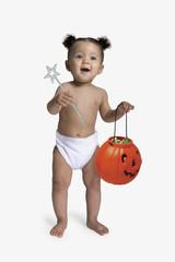 African baby holding jack-o-lantern