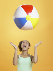 African girl playing with beach ball