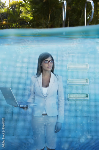 South American businesswoman in swimming pool
