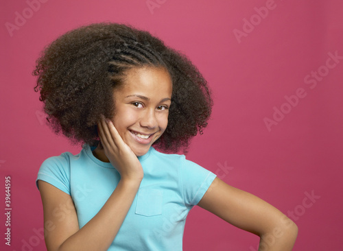 African girl with hand on cheek