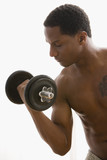 African American man lifting dumbbell