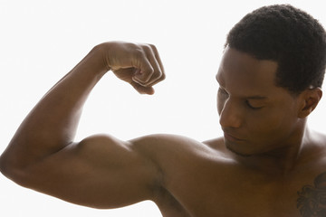 African American man flexing biceps