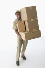 African American delivery man carrying boxes