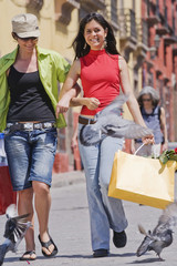 Hispanic women carrying shopping bags