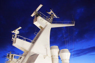 the chimney of the ship during the night on a blue background